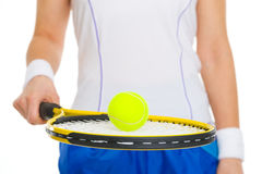 Tennis ball on racket in hand of tennis player Royalty Free Stock Image