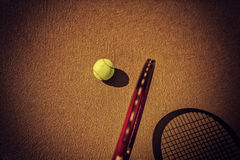 Tennis ball and racket on hard court Royalty Free Stock Photo