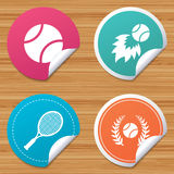 Tennis ball and racket icons. Laurel wreath. Round stickers or website banners. Tennis ball and racket icons. Fast fireball sign. Sport laurel wreath winner Royalty Free Stock Images