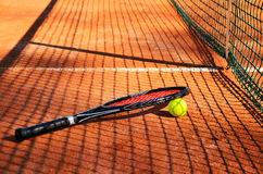 Tennis ball and racket are near the net horizontal Stock Images