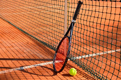 Tennis ball and racket are near the net horizontal side view Stock Images
