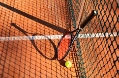 Tennis ball and racket are near the net horizontal 0193 Stock Photography