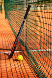 Tennis ball and racket are near the net vertical Royalty Free Stock Photos