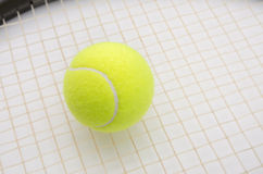 Tennis ball on racket Royalty Free Stock Photography