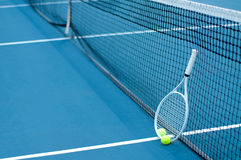 Tennis ball and racket on tennis court stock images