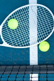 Tennis ball and racket on tennis court royalty free stock photo