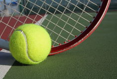 Tennis ball and racquet. On the court Royalty Free Stock Images
