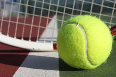 Tennis ball and racquet Stock Images