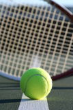 Tennis ball and racquet stock photo