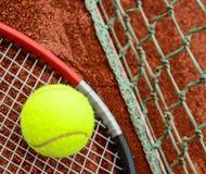 Tennis ball and racquet closeup stock image