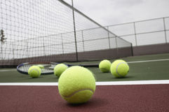 Tennis ball and racquet on Court Royalty Free Stock Photo