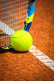 Tennis Ball and Racquet on the court Royalty Free Stock Photos