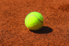 Tennis ball at red clay tennis court Stock Image