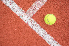 Tennis ball on Running track Stock Photo