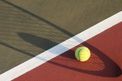 Tennis Ball Shadow of Racket stock photo
