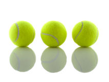 Tennis ball shadows. Three tennis balls reflecting shadows on a mirror Stock Images