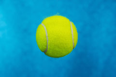 Tennis Ball in Sky Blue Background Royalty Free Stock Images