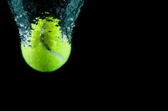 Tennis ball speeding through water Royalty Free Stock Photos