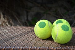 Tennis ball on a step of the ladder Royalty Free Stock Photo