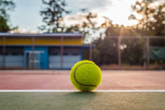 Tennis ball with sunlight. Tennis ball with blur background and sunlight Royalty Free Stock Images
