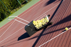 Tennis Ball Sweeper Royalty Free Stock Image