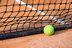 Tennis ball on a tennis court Royalty Free Stock Photography