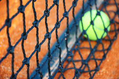 Tennis ball on a tennis clay court Stock Image