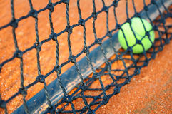 Tennis ball on a tennis clay court Stock Images