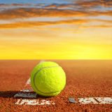 Tennis ball on a tennis clay court Royalty Free Stock Photos