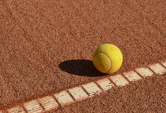Tennis ball in the tennis clay field Stock Image