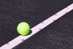 Tennis ball on tennis court Royalty Free Stock Photos