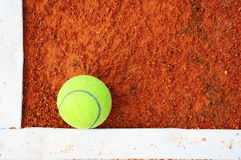 Tennis ball on a tennis court Stock Photos