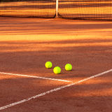 Tennis ball on a tennis court Royalty Free Stock Photos