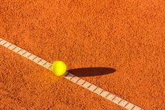 Tennis ball on a tennis court Stock Image
