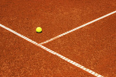 Tennis ball on tennis court. Clay surface. Royalty Free Stock Photography