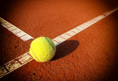 Tennis ball on a tennis court Stock Images