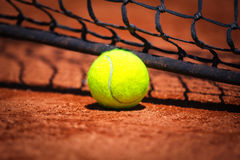 Tennis ball on tennis court Royalty Free Stock Image