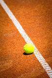 Tennis ball on tennis court Royalty Free Stock Photography