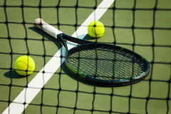 The tennis ball on a tennis court. The green tennis ball on a tennis court stock photos