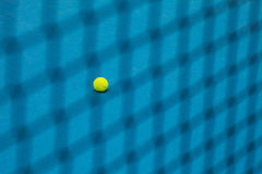 The tennis ball on a tennis court royalty free stock images