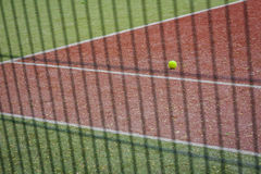 A tennis ball on the tennis court. Stock Photo