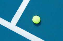 Tennis ball on tennis court with white line Stock Photo