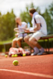 Tennis ball on tennis court. Yellow tennis ball on dross tennis court royalty free stock images