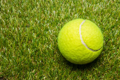 Tennis ball on tennis grass court Royalty Free Stock Photo