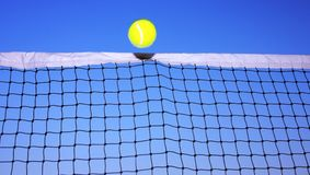 Tennis ball and tennis net Royalty Free Stock Images