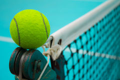 Tennis ball and tennis net. Set up on net Royalty Free Stock Photo