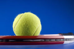Tennis ball and a tennis racket Stock Image