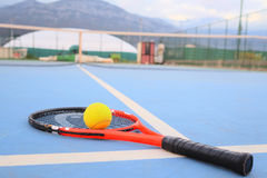 Tennis ball and tennis racket Royalty Free Stock Image