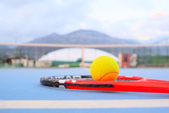 Tennis ball and tennis racket royalty free stock photo