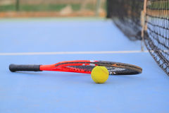 Tennis ball and tennis racket Stock Images